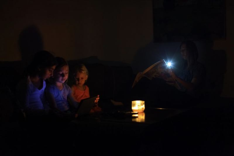 Young Kiwi family getting through a power outage