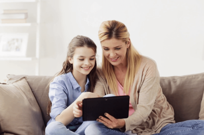 A mother and daughter search for cheap broadband deals online