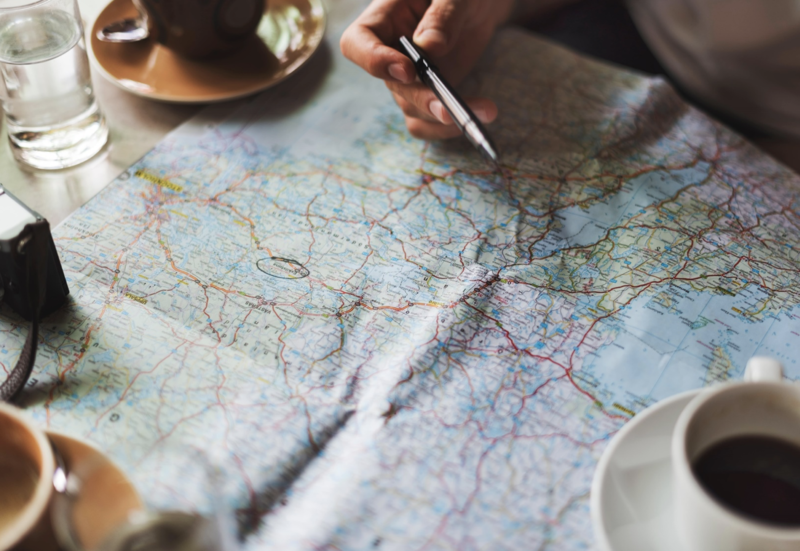Planning a trip with map and coffee