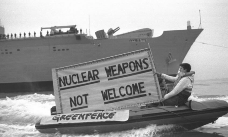 In 1988, a Greenpeace member shows his support in a nuclear free protest in New Zealand