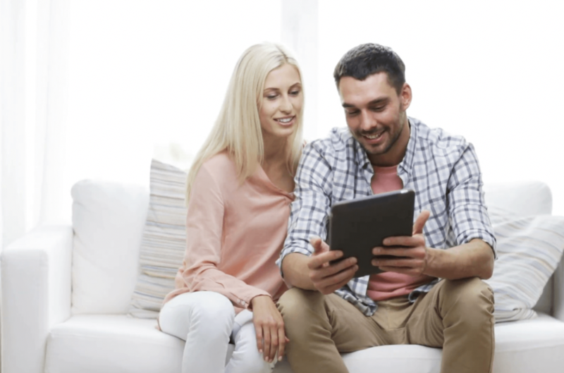 Couple looking online for the best broadband deals of 2019