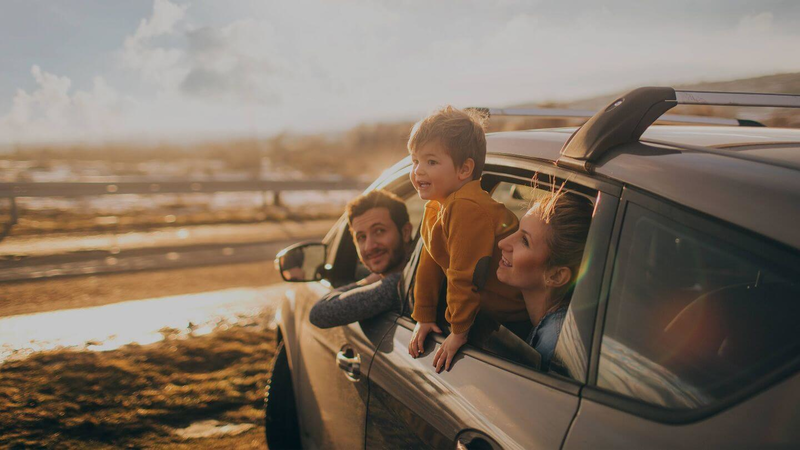 Kiwi family enjoying a road trip covered by full comprehensive car insurance
