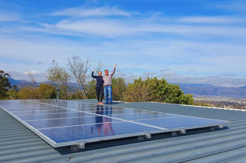 Kiwi couple with their new solar power system