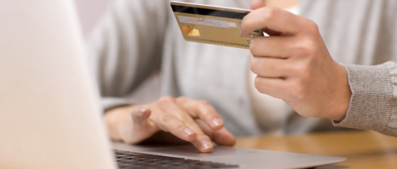 Person paying their credit card bill late
